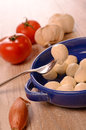 Mozzarella with cooking ingredients on a wooden table Stock Images
