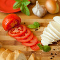 Mozzarella and fresh tomatoe italian cheese with tomatoes baguette cut cheese cut tomatoes are surrounded by baguette Stock Image