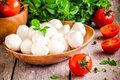 Mozzarella organic cherry tomatoes and fresh basil on a rustic wooden background Royalty Free Stock Images