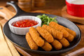 Mozzarella sticks delicious breaded cheese with marinara dipping sauce Royalty Free Stock Images