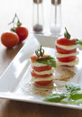 Mozzarella and tomato with fresh basil Stock Photo