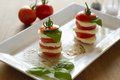 Mozzarella and tomato with fresh basil Royalty Free Stock Image
