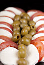 Mozzarella, tomatoes and olives Royalty Free Stock Photo