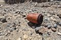 Mpty rusty soda can on stony soil civilization symbol Royalty Free Stock Images
