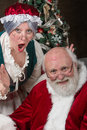 Mr and mrs santa clause stopped by for a photo shoot before heading back to the north pole to finish building all the toys for Royalty Free Stock Photography