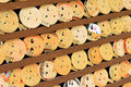 Mrror-shaped wooden preyer tablets (Kagami ema) in Kyoto, Japan. Royalty Free Stock Photo