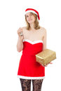 Mrs claus with bell and golden gift smiling Royalty Free Stock Photos