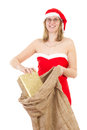 Mrs claus with jute bag and golden gift smiling Stock Photos