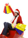 Mrs. Claus with shopping bags Stock Image