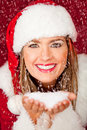 Mrs. Claus under falling snow Stock Photo