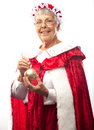Mrs clause isolated white holding gold christmas ornament Stock Images