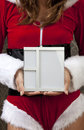 Mrs clause with a picture frame is showing us an empty Royalty Free Stock Photography
