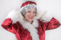 Mrs santa clause here is hamming it up at a photo shoot Stock Image