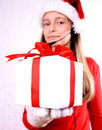 Mrs. Santa with a headset and gift Royalty Free Stock Photo