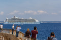 Ms allure of the seas leaving palma people watching largest cruise ship in world harbour Stock Photo