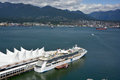 Ms radiance of the seas vancouver bc canada june is a cruise ship in canada place is home convention centre and flyover Stock Image