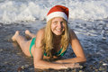 Ms santa in the ocean Stock Photo