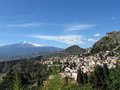 Mt. Etna across the town of Taormina Royalty Free Stock Photo
