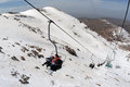 Mt hermon israel isr mar visitors sit in chair lift on on mar it s summit straddles the border between syria and lebanon and Royalty Free Stock Image