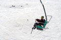 Mt hermon israel isr mar visitors sit in chair lift on on mar it s summit straddles the border between syria and lebanon and Stock Photography