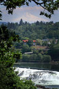 Mt hood over willamette falls a territorial view of in the distance city and Royalty Free Stock Photos