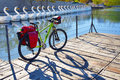 Mtb bicycle touring bike in a park with pannier racks and saddlebag Stock Photo