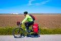Mtb biker bicycle touring with pannier racks and saddlebag Royalty Free Stock Photo