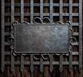 Mteal plate on medieval castle gate or wall background Royalty Free Stock Photo