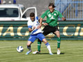 Mtk vs paks otp bank league football match budapest may duel between patrik vass of l and janos szabo of during at Stock Photo