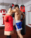 Muay thai elbow hit on mannequin fighter exercising style technique a Stock Image