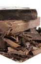 Mucchio del cioccolato sulla zolla bianca Fotografia Stock