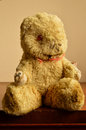 Much loved teddy bear an old battered Royalty Free Stock Images