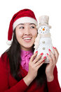 Muchacha asiática hermosa con el muñeco de nieve Foto de archivo