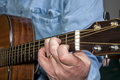 Mucisian plays a C cord on an Acoustic guitar Royalty Free Stock Photos