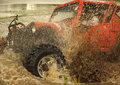 Mud blogging x spinning as an offroader drives through muddy waters Royalty Free Stock Image