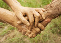 Mud hands connected together Royalty Free Stock Photo