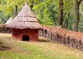 Mud hut with straw roof old Stock Photo
