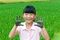 Mud little girl the whose hands covered with Stock Photography