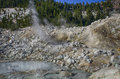 Mud pots and sulpher vents a view of fumaroles steam located at bumpass hell in lassen volcanic national park Royalty Free Stock Photography