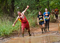 Mud race participants wearing costumes Royalty Free Stock Photo