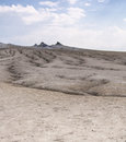 Mud volcano cones and dry land photo taken at volcanos site Stock Photos