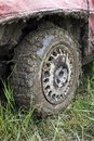 Muddy car tire Royalty Free Stock Photography