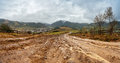 Muddy ground after rain in mountains. Extreme path rural dirt ro Royalty Free Stock Photo