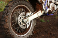 Muddy rear wheel of dirt bike Royalty Free Stock Images