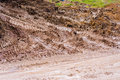 Muddy village road with truck tracks detail of a after the rain deep tire of heavy duty trucks a typical view from country turkey Royalty Free Stock Photo