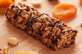 Muesli bar with chocolate on wooden board Royalty Free Stock Photo