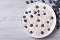 Muesli with blueberries and milk top view horizontal Royalty Free Stock Photo