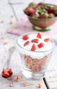 Muesli with cream and strawberry on wooden table pieces rusted background Royalty Free Stock Photos