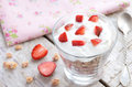 Muesli with cream and strawberry on wooden table pieces rusted background Stock Photos
