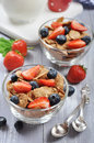 Muesli and fresh berries glass bowl with healthy on a wooden background Royalty Free Stock Image